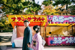 A couple in Kitano, Kyoto wearing kimono enjoying a Japanese festival
