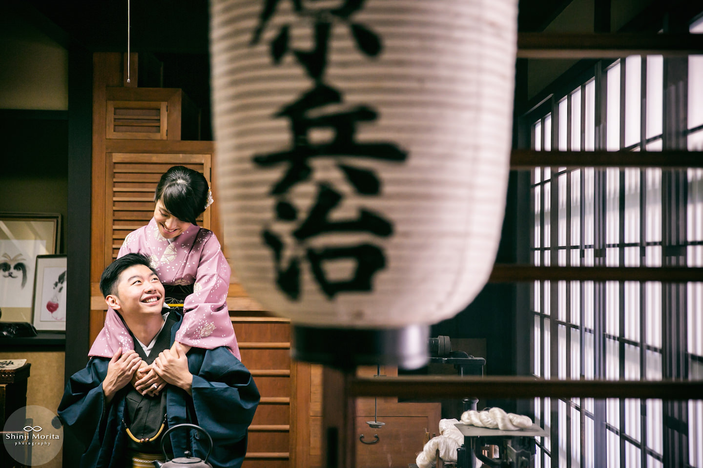 A couple wearing kimono in old traditional Japanese house