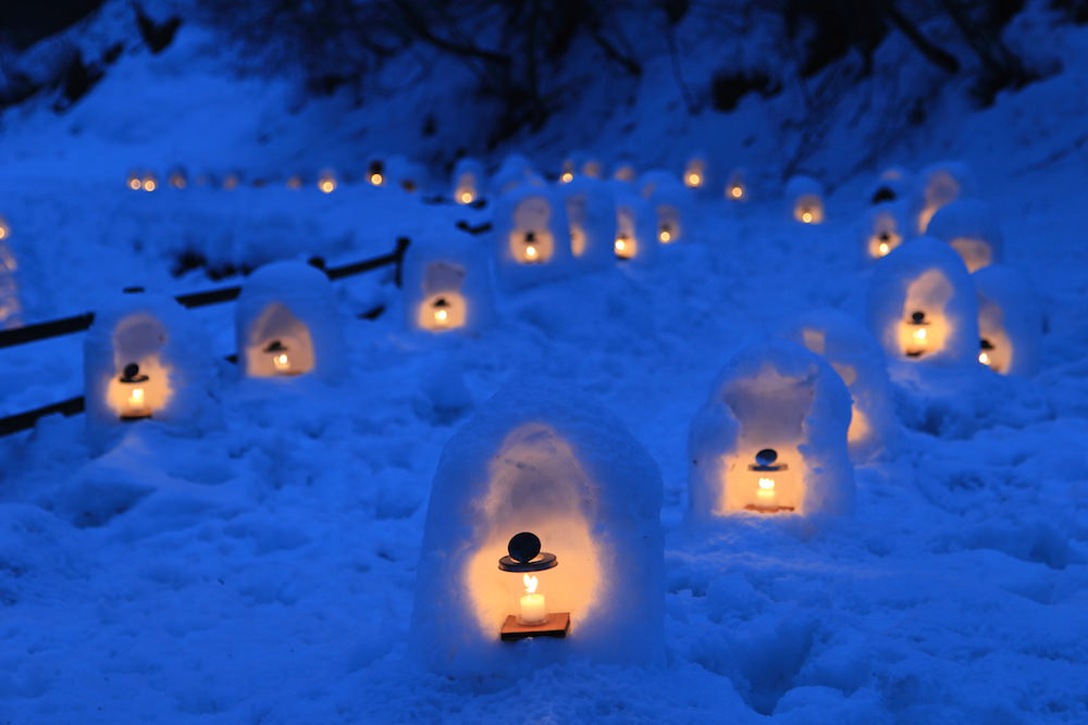 Small snow hut being lit up in Otaru in winter
