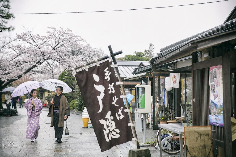 Vacation photo of a couple in Kimono strolling around Arashiyama, Kyoto