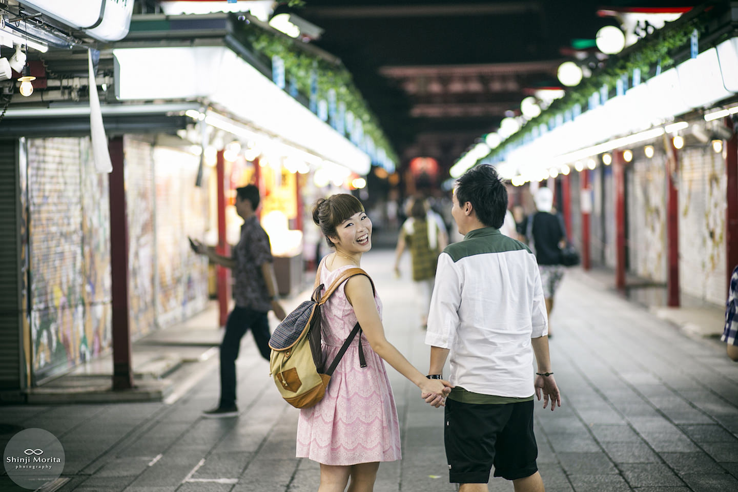 A happy couple walking around Nakamise street in Asakusa, Tokyo