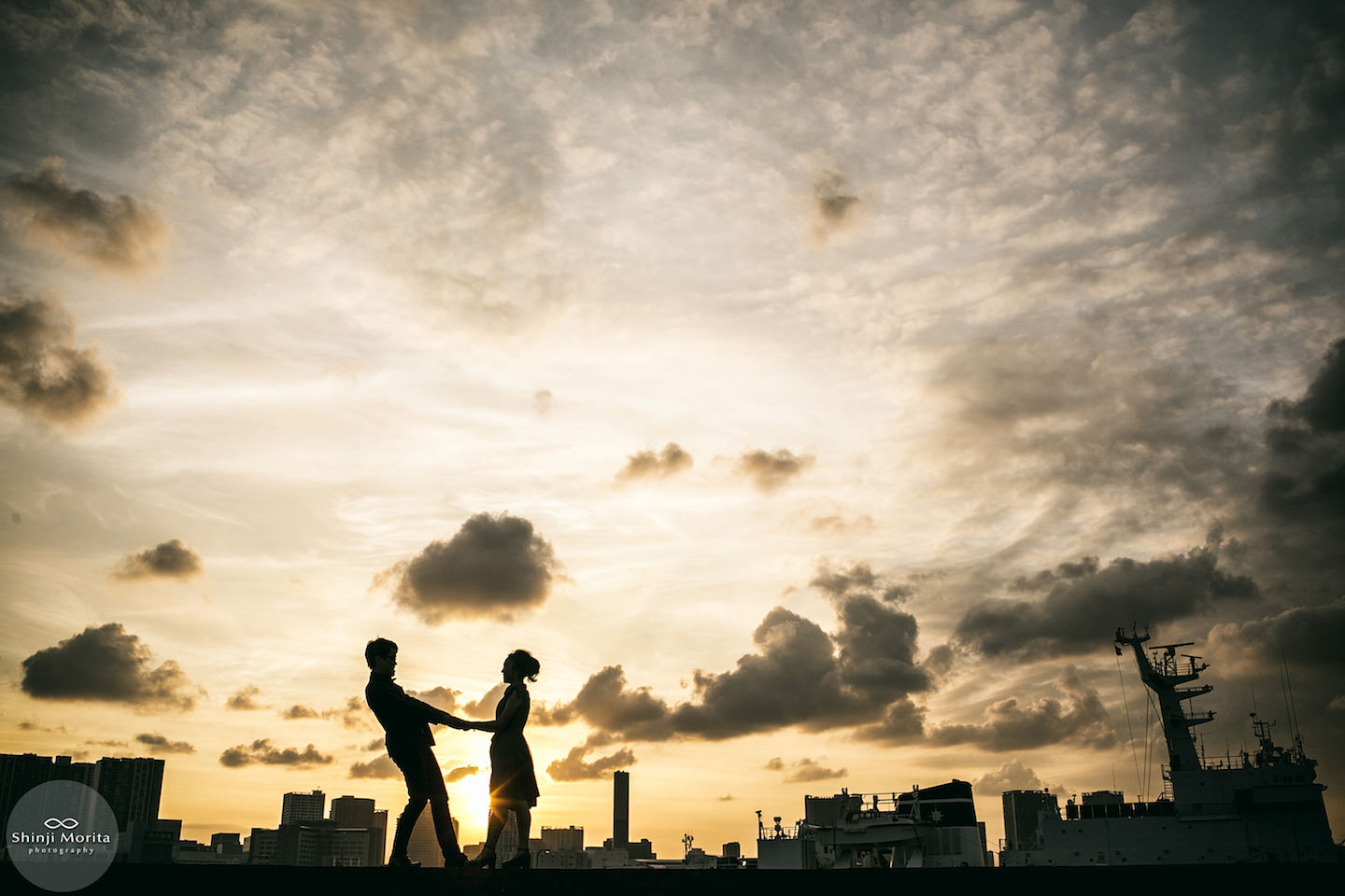 A couple holding hands in Odaiba bay area during sunset