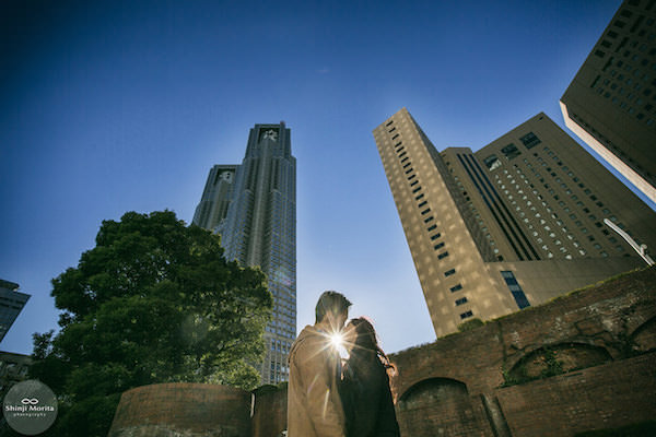A couple kissing in front of Tokyo Government office in Shinjuku
