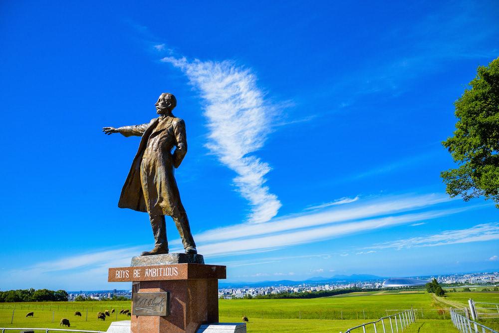 Dr. Clarke statue in Sapporo inside Hokkaido University on a sunny day in summer