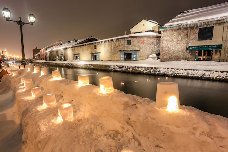 Otaru canal being lit up covered in snow in winter