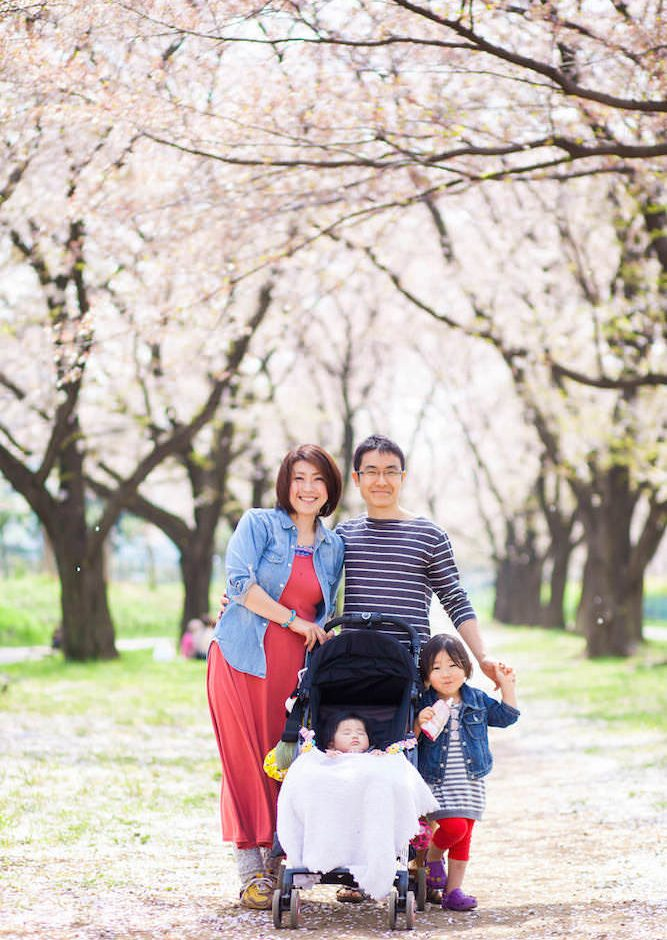 Family vacation photo during cherry blossom season in Japan