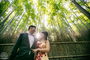 A couple looking at each other romantically in the bamboo grove in Arashiyama, Kyoto
