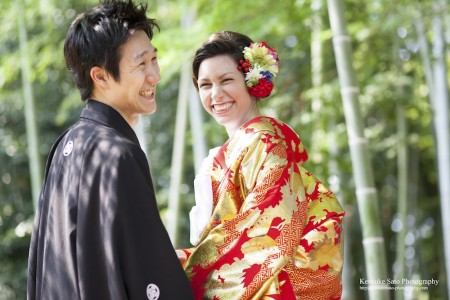 A couple dressed in kimono for pre-wedding photo in bamboo grove