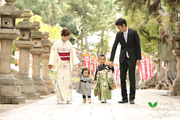 Vacation photo of a family visiting nearby shrine dressed up in kimono