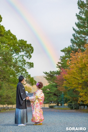 A couple looking a the beautiful rainbow with kimono for pre-wedding photo