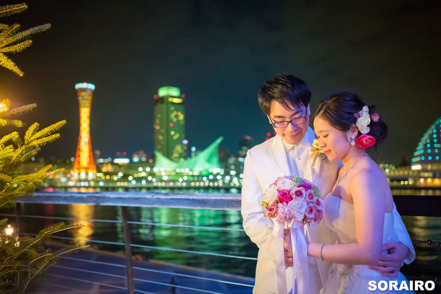 A couple posing in front of the camera with beautiful night view of Kyoto for pre-wedding photo