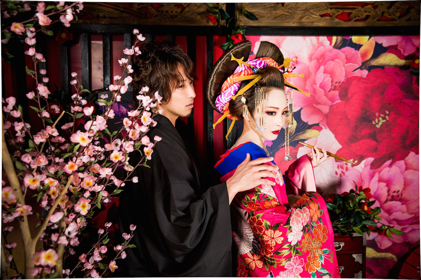 Man and Woman dressed up with Kimono. The woman is known as Oiran who looks very sexy and was a fashion leader in ancient Kyoto. Photo taken by Studio Esperanto.