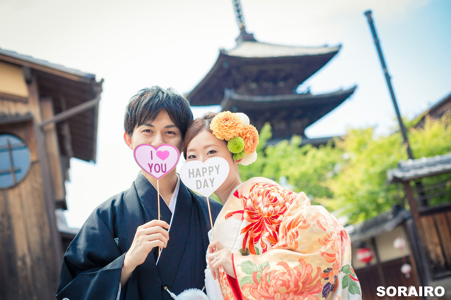 A couple holding props for pre-wedding photo