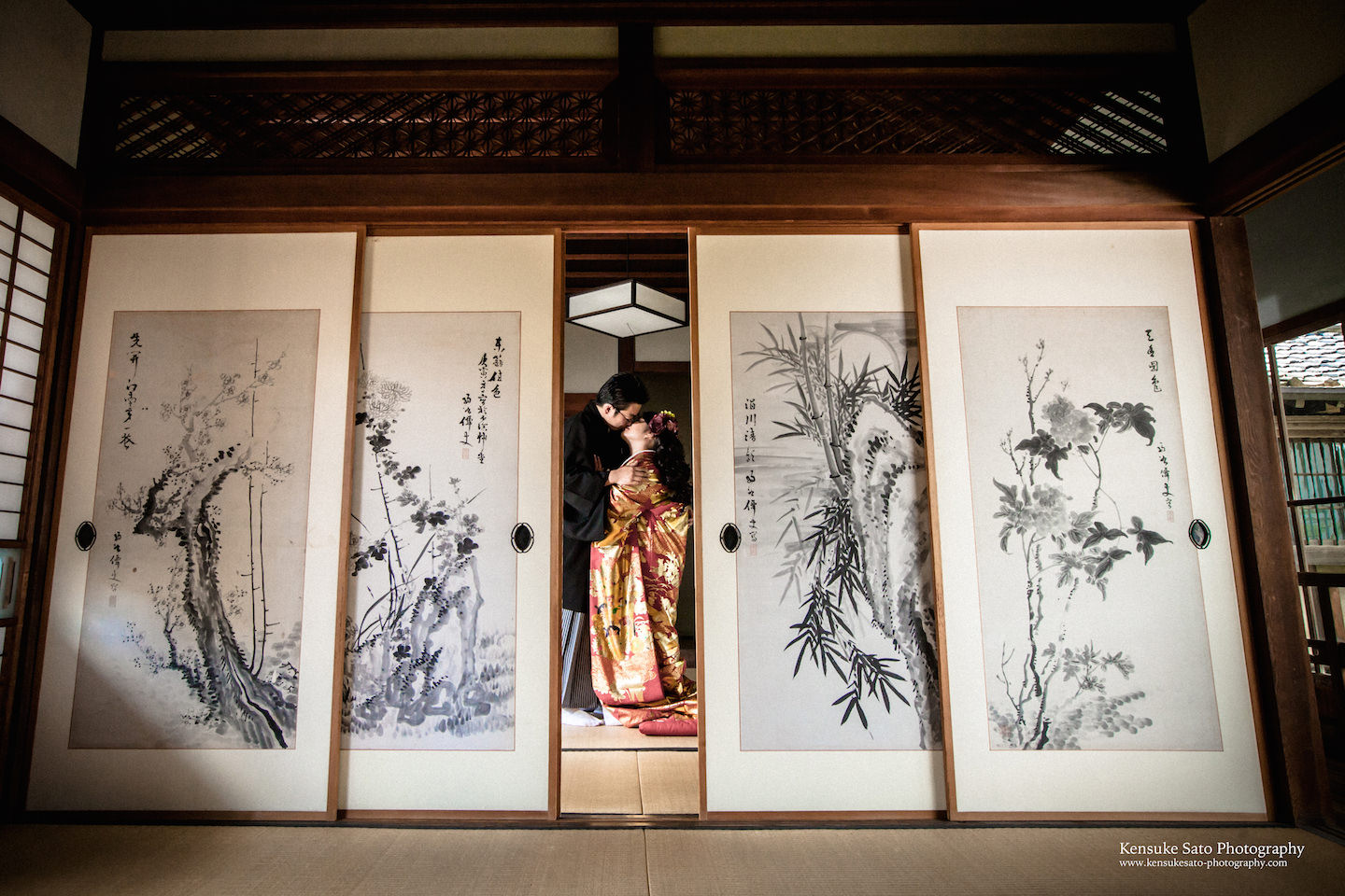 A couple kissing wearing a beautiful kimono in an authentic Japanese house for pre-wedding photo