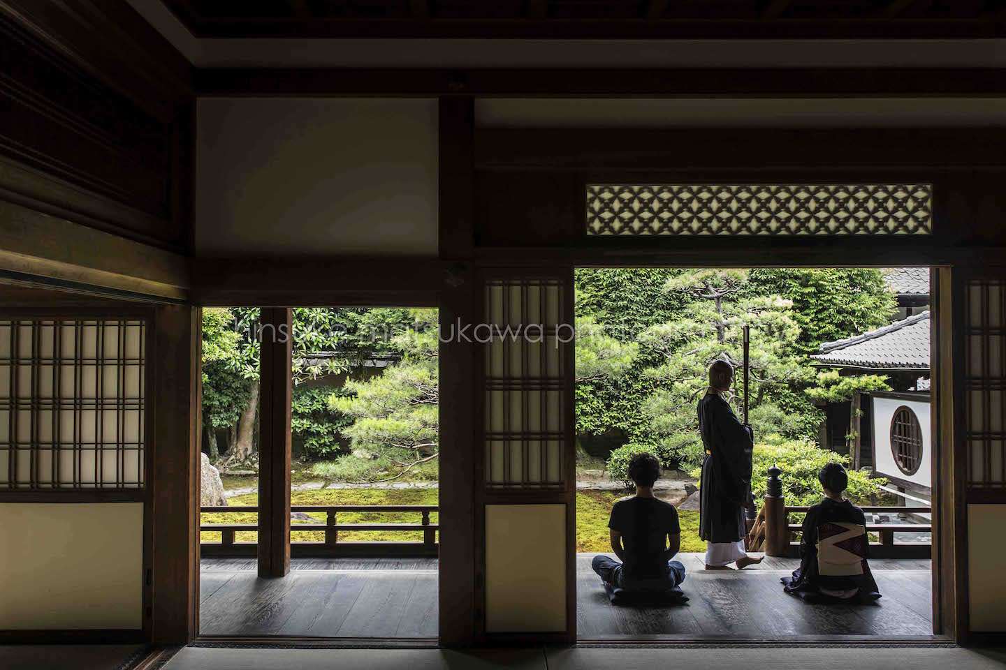 A couple feeling zen in the temple in Kyoto looking at the Japanese garden