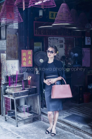 A woman posing in front of Chinese shop in Tokyo for solo vacation photo