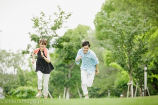 A couple running in a fresh green park