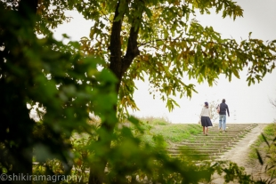 A couple walking up the stairs in the park