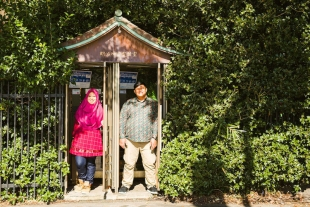 Vacation photo of a couple posing at a telephone booth in Yoyogi park, Tokyo