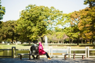 Vacation photo of a couple relaxing at Yoyogi park, Tokyo
