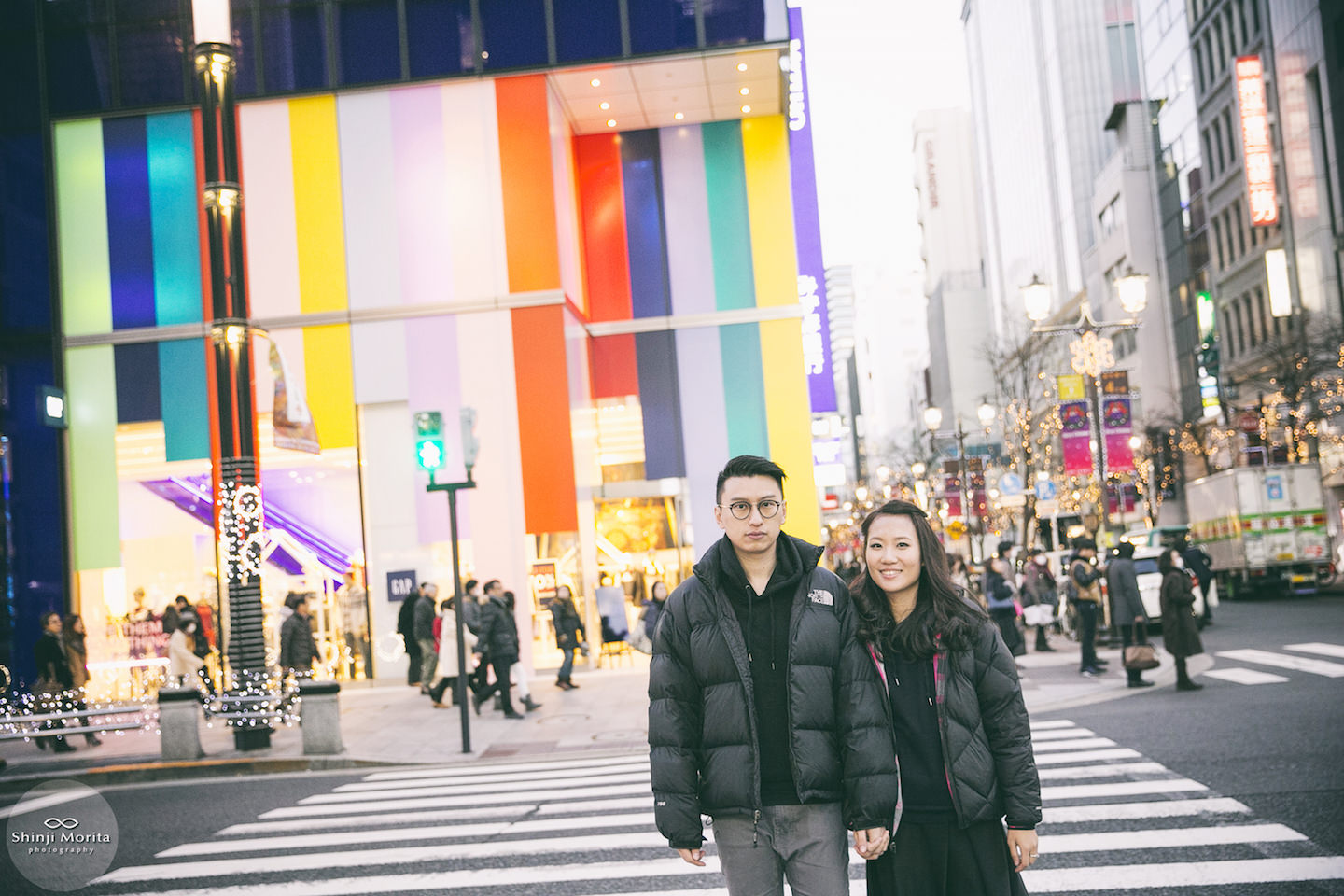 A couple holding hands and walking around Ginza shopping area in Ginza, Tokyo