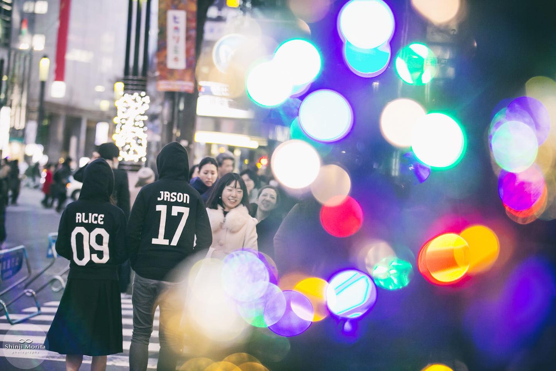 A couple wearing the matching sweatshirt, walking Ginza shopping area in Tokyo