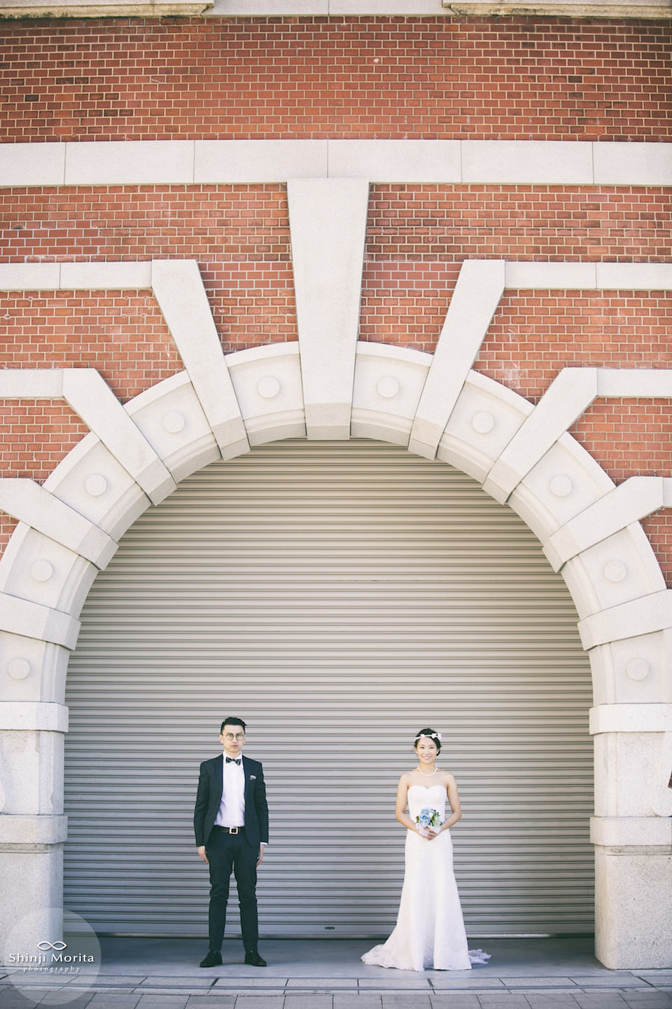 A couple dressed up near Tokyo station for pre-wedding photo