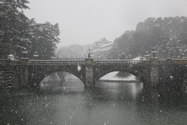 Imperial palace covered in snow during winter time in Tokyo