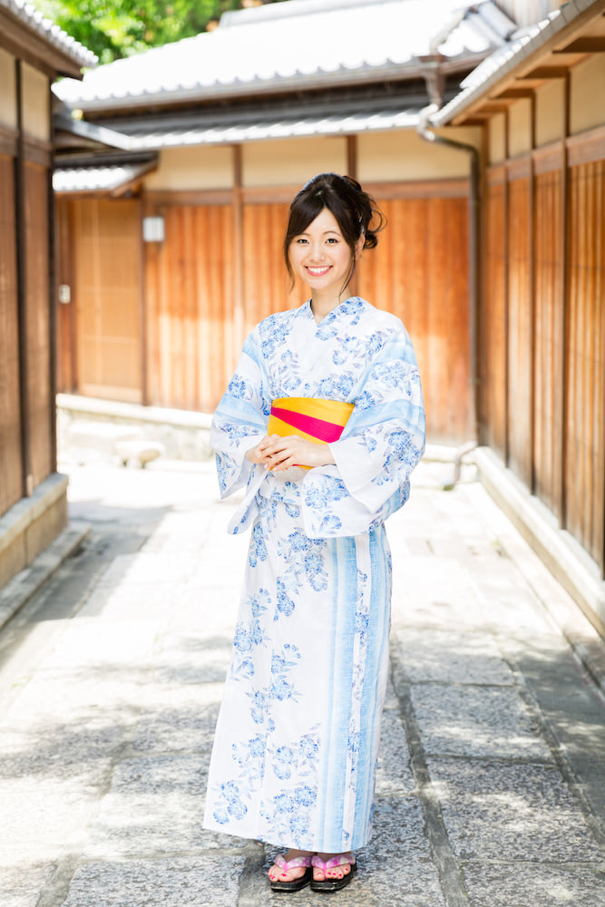 A woman dressed in blue kimono in Gion, Kyoto