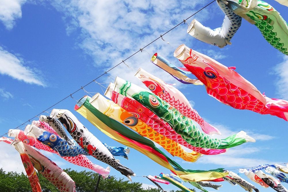 Carp streamer swimming with blue sky in the background