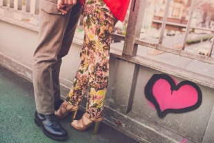 Pre-wedding photo of couple as they stand in the street of Tokyo