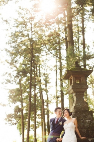 A couple smiling at cedar forest in Hakone for pre-wedding photo with CHiKA