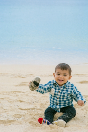 Family vacation photo of a baby boy having fun at the beach in Okinawa