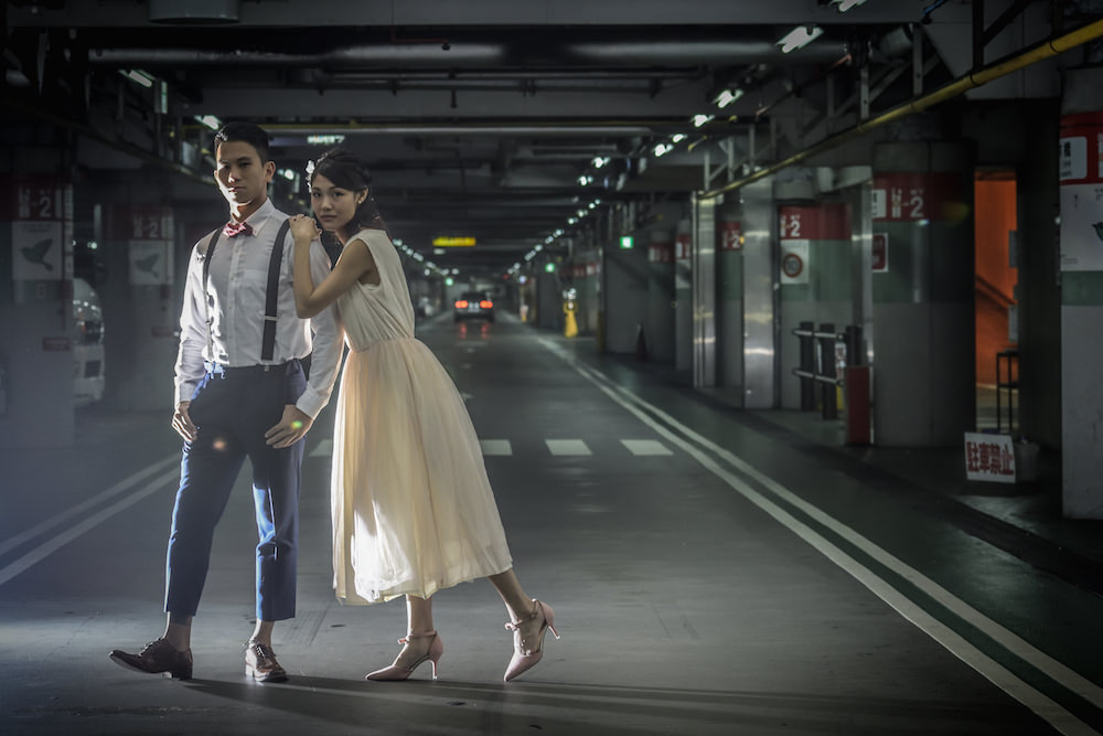 Pre-wedding photo of a couple posing in front a camera in Osaka