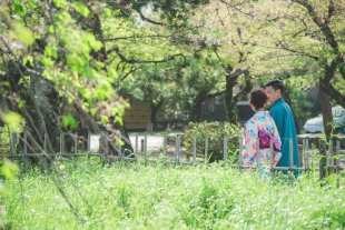 Vacation photo of a couple walking along Arashiyama area